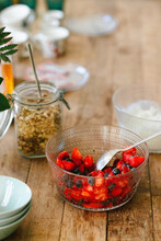 Breakfast Brunch Table With Granola, Blueberries, Strawberries And Yoghurt On A Wooden Table