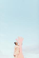 Creative Minimal Fashion Portrait Of Fashionable Teen Girl With Hand Shaped Figure