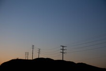 A Photo Of Telephone Pole Shadows At Sunset