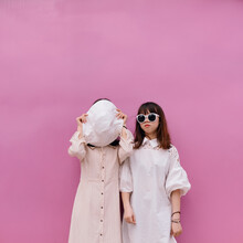 Funny Portrait Of Two Fashionable Women