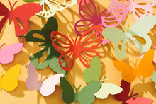 Paper Cut Out Butterflies, On Yellow Background