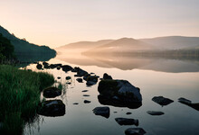 Hallin Fell, Mist And Reflections On Ullswater At Sunrise. Lake District, Cumbria, UK.