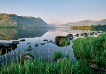 Place Fell, Mist And Reflections On Ullswater At Sunrise. Lake District, Cumbria, UK.