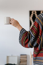 Woman In Knitted Wear With Cup Of Hot Drink