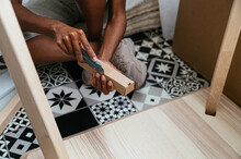 Anonymous Woman Unpacking Box With Furniture Details