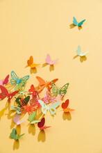 Paper Cut Flying Butterflies On A Yellow