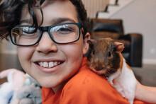 Boy With Pet Guinea Pig.