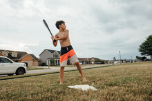 Boy Playing Baseball In His Swimsuit.