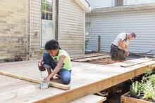 Tween Girl Using Power Tools To Help Build An Outdoor Deck