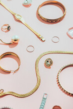 Jewellery,diamonds, Ruby, Gold, Silver Etc/ On Pink Background