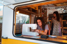 Woman Sewing Clothes In Van