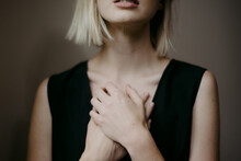 Woman's Hands Over Heart