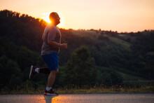 Man Running On An Open Road