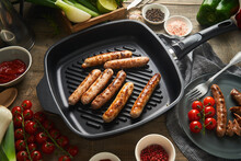 Grilled Sausages On Pan In Kitchen