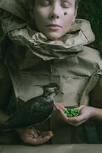 Girl Feeding A Bird Concept Portrait