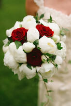 Wedding Bouquet With White Peonies, Ivy And Red Roses