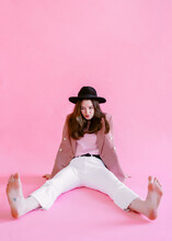Girl In Pink Clothes Posing On A Solid Pink Background In The Studio, Positive Atmosphere
