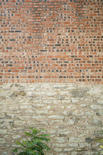 An Old Brick Wall With Multicolored Bricks