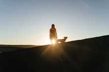 Woman And Puppy Sunset