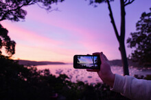Taking Photo Of Sunset