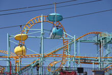 Sky Ride With Roller Coaster In The Background