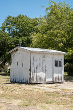 A Worn White Shed In The Sun