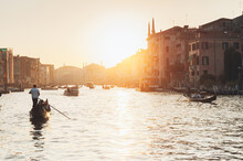 Gondolas And Boats In The Grand Canal During Sunset