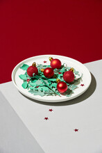Small Red Christmas Balls In A White Plate