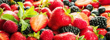 Berries Colorful Assorted Mix Of Strawberry, Blueberry, Raspberry, Blackberry On Dark Background