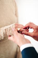 Groom Putting On Two Wedding Rings