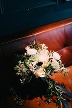 Wedding Bouquet On A Hidden Bench At Indoor Wedding Venue