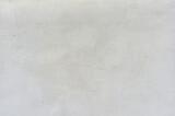 Fototapeta Nowy Jork - Trozo de pared blanca con defectos,grietas y manchas, con textura aspera y manchas. Fachada tipica de las casas blancas de Ibiza,España