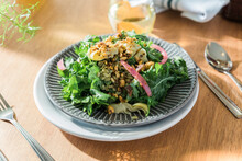 Kale Salad Plated On Table In Diner Booth