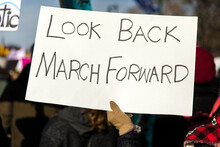 Sign Reading Look Back March Forward