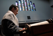 Synagogue: Man Stands On Bimah Reading From Torah
