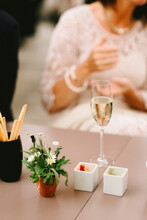 Glass Of Champagne With Bread Sticks On A Wedding Reception