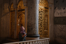Traveller Woman In A Cathedral