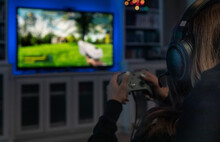 Girl Plays Modern Shooter Video Game On TV