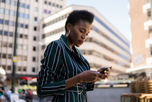 Young Business Woman Using Cellphone