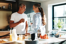Mature Couple Talking Over Coffee At Home