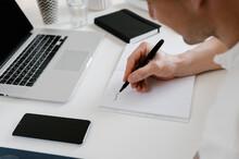 Entrepreneur Making Notes In Planner
