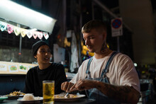 Couple Eating Street Food In Thailand