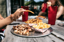 BBQ: Woman Taking French Fry From Plate