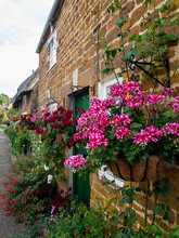 Pretty Row Of Terraced Cottages In Rural England