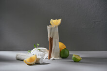 Lemon, Lime, Cinnamon And Mint On A White Background On Gray Cement Background.