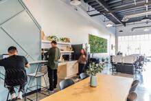 Motion Blur Woman Walks In Modern Office