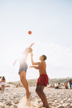 Kids Playing With A Ball At The Beach