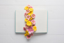 Flowers Filling Open Book