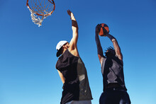 Friends Shooting Baskets Together Outside