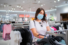 Woman With Mask Doing Shopping.